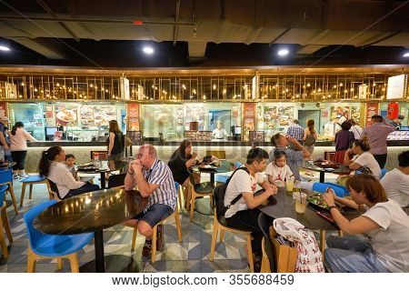 SINGAPORE - JANUARY 20, 2020: people eating at a food court in the Shoppes at Marina Bay Sands.