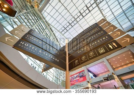 SINGAPORE - JANUARY 20, 2020: low angle view of direction signs seen at the Shoppes at Marina Bay Sands