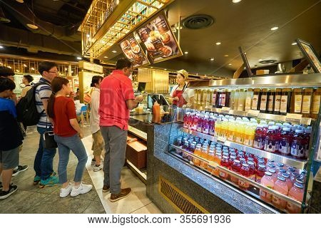 SINGAPORE - JANUARY 20, 2020: people queue at a food court in the Shoppes at Marina Bay Sands.