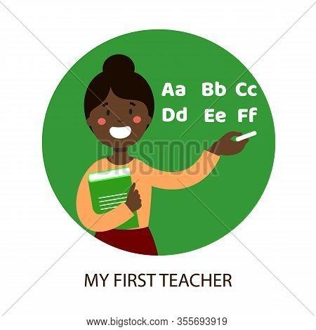 Black Teacher Write In Chalk On Blackboard. Write Letters In Chalk On Blackboard. First Teacher. Pri