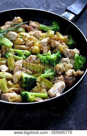 Boneless Chicken Meat Pieces With Green Vegetables: Zucchini, Broccoli, Onion, And Rosemary On A Ski