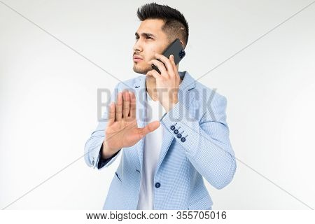 Portrait Of A Businessman In A Blue Jacket Talking Seriously With Partners On The Phone With The Exp