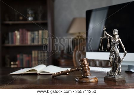 Lawyers Office Concept. Law Symbols Composition - Gavel And Themis Statue On  Wooden Shining Desk.