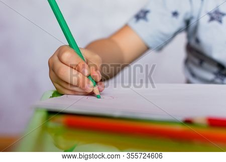 Close-up Of Childs Hands Drawing. Boy, Drawing A Picture For Fathers Day. Small Boy Draws At The Tab