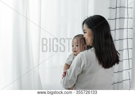 Young Beautiful Asian Mother With Her Little Cute Newborn Baby 0-1 Month At Home And Mother Hold New