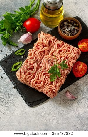 Mince. Fresh Raw Minced Beef On Cutting Board And Ingredients For Cooking On A Stone Or Slate Table.