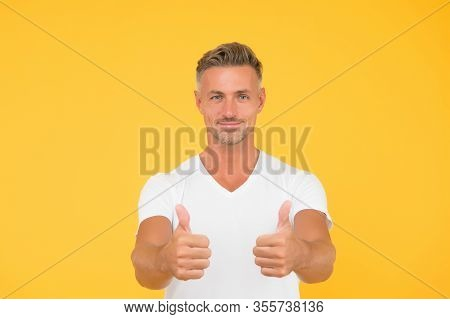 Visual Advertising. Happy Guy Show Thumbs Ups. Advertising Agent Yellow Background. Approving And Ad