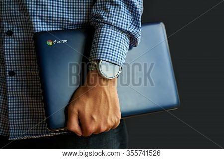 Bishkek, Kyrgyzstan - June 6, 2019: Man Holding A Asus Chromebook.