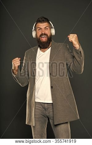 Hear My Voice. Bearded Man Enjoy Singing To Vocal Melody. Happy Hipster Do Vocal On Song Grey Backgr