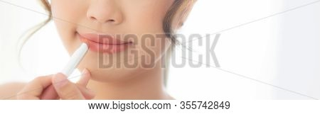 Beautiful Portrait Young Asian Woman Looking Mirror Applying Makeup Lipstick At Room, Beauty Lips As