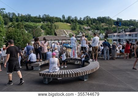 People Take Place On New Round Bench At The New Designed Area Stapferschulhaus Brugg To Listen To Th