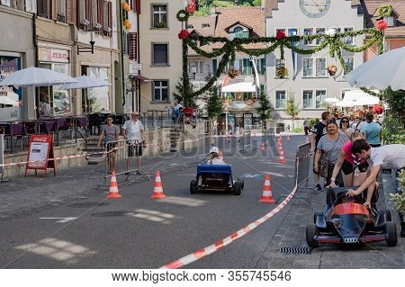 Go Karting On The School Games Afternoon With Spectators In The Old Town Of Brugg On The 4th Of July