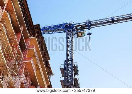Construction Crane Near The Building Under Construction. Construction Site.
