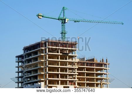 Construction Site Background. Hoisting Crane And New Multi-storey Building. I.ndustrial Background.