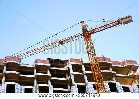 Construction Site With Crane And Building. Crane Near Building