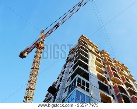 Construction Site With Crane. Construction Of The Multi-storey Building. Industrial Background.