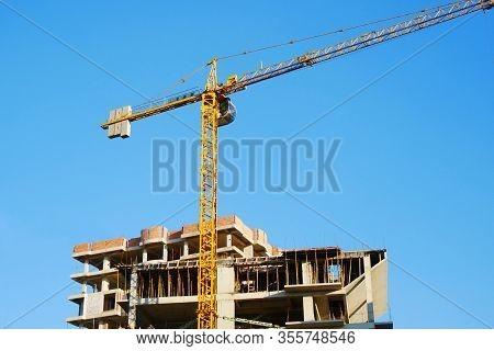 Construction Site. Building Site With Crane. Concrete Building Under Construction