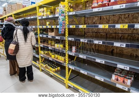Montreal, Ca - 15 March 2020: Empty Shelves In A Maxi Supermarket. Shortage Of Supplies Due To Panic