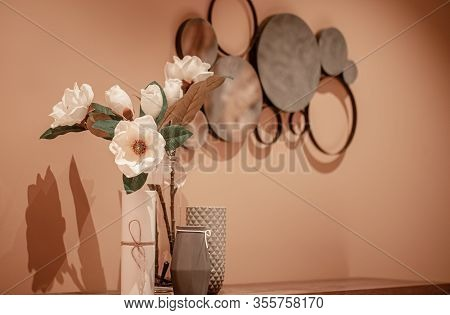 Interior Design With A Vase And Artificial Flowers On The Table.
