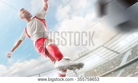Soccer Player In Action. Plays On A Professional Stadium. Sport Action. Close Ups. The Stadium In 3d