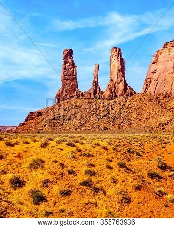 The Three Sisters, A Massive Red Sandstone Pinnacle Formation In Monument Valley, A Navajo Tribal Pa