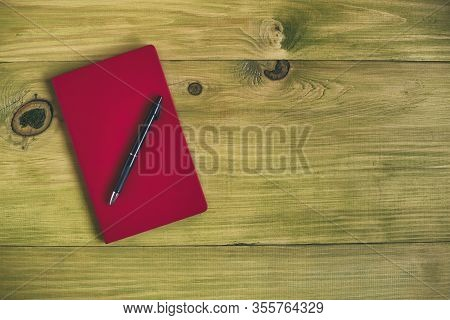 Image Of Personal Organizer And Pen Wooden Table.