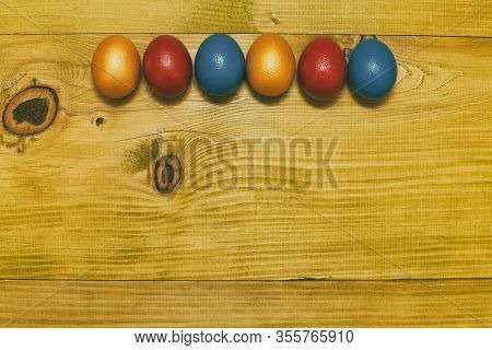 Image Of Painted Easter Eggs On Wooden Table.