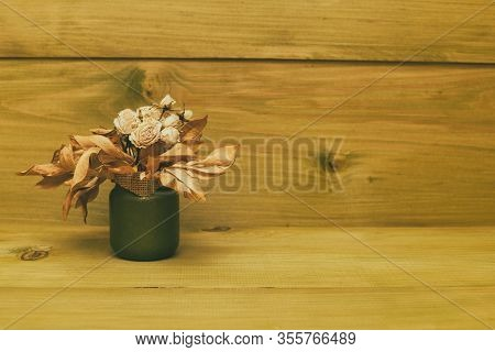 Image Of Vase With Dried Flowers On Wooden Table