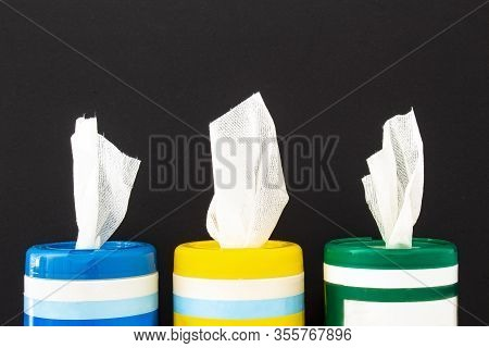 A Close Up Of Disinfecting Wipes On A Black Background