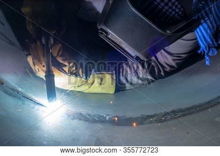 Welder Performs Welding Work Semi-automatic Electric Arc Welding. Stainless Steel Pipe Welding. Pipe