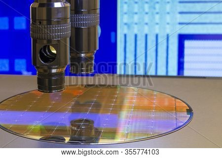 Silicon Wafer With Semiconductor Microchip On Machine Process Examining Testing In Microscope.