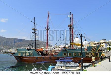 Hersonissos, Crete, Greece - June 11, 2019 : Pirate Ship In Hersonissos Harbour A Popular Tourist At