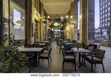 Budapest, Hungary - February 16, 2020: Pubs And Bars With A Few People Sitting On Madach Square Near