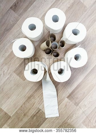 Bouquet Of Empty And Full White Toilet Paper Rolls Stacked