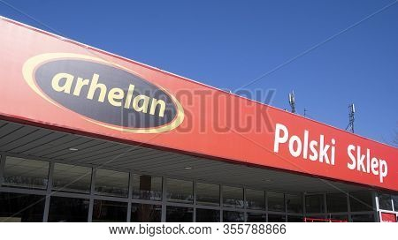 Warsaw, Poland. 15 March 2020. Sign Arhelan - Polski Sklep. Company Signboard Arhelan - Polski Sklep