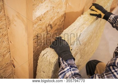 Synthetic Mineral Fibers Wall Insulation Job. Construction Worker Insulating House Walls With Therma