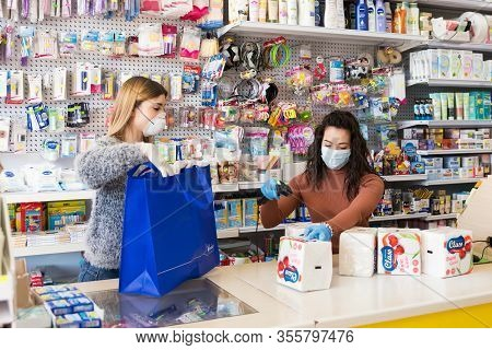 Avetrana, Italy, - Marth, 13, 2020. Two Young Salesewomen With Medical Mask And Gloves Working At Th