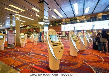 SINGAPORE - CIRCA JANUARY, 2020: self-service check-in facilities at Terminal 1, Changi Airport. Changi Airport is a major civilian airport that serves Singapore.