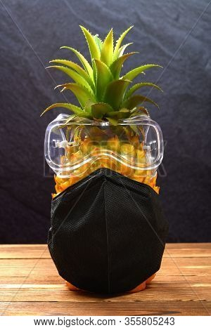 Well Protected Pineapple Wears A Medical Mask And An Eye Protector Concept Of Protecting Oneself Aga