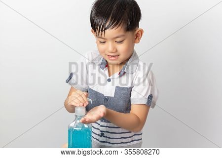 Asian Boy Using Alcohol Antiseptic Gel For Cleaning Baby Hands To Prevent Against Infection Of Covid
