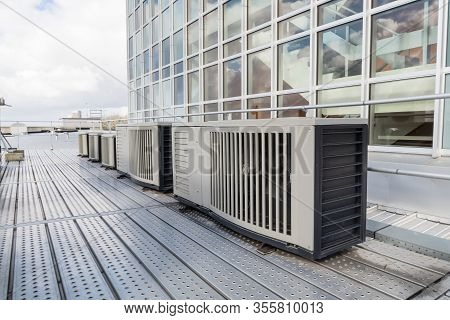 On An Flat Roof There Cooling Air Conditioning On A Big Building