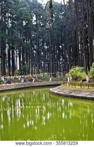 Lamahata, Darjeeling, India- December 26, 2019: Lake Spring View With Mountain Lake, On The Top Of L
