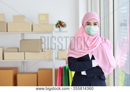 Beautiful Muslim Young Asian Woman Wearing Blue Suit With Medical Protective Face Mask To Protect In