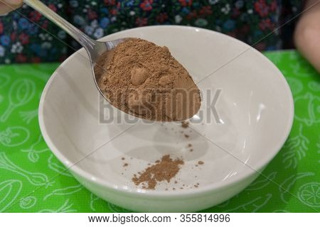 Cocoa Powder In A Tablespoon With A Slide Before Sifting - Horizontal Food Photo
