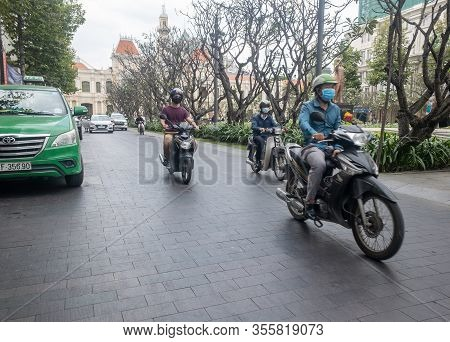 Ho Chi Minh, Vietnam - December 17, 2019 - Before The Corona Virus Pandemic People On Scooters With