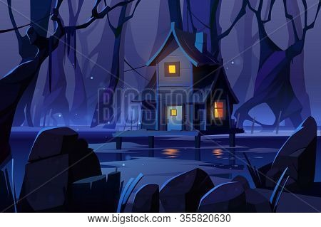 Wooden Stilt House On Swamp In Night Forest. Old Shack With Glow Windows Stand On Piles In Deep Wood