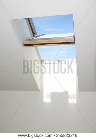Close-up Of Open Wooden Skylight Window In The House Room. Open Attic Skylight Window Indoor