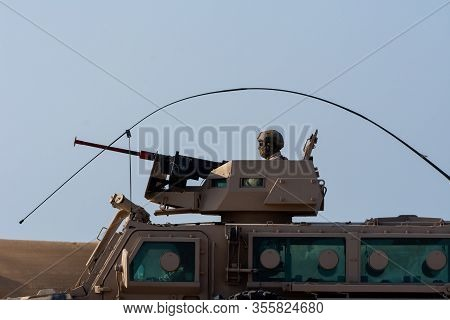 Military Tank Army Vehicle Close Up Of Guns And Military Personel Aiming And Shooting. Military And