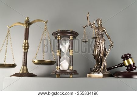 Lawyers Office Concept. Law Symbols Composition - Gavel, Scale And Themis Statue On Off-white Backgr