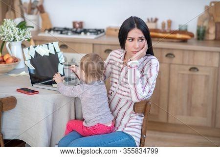 Stressed Mom Holding Daughter, Kid Disturbing Her